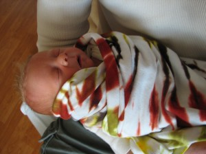 Loving the blanket his mommy dyed for him!